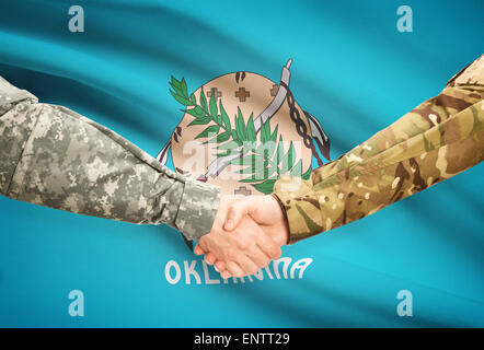 Soldiers handshake and US state flag - Oklahoma - Stock Photo