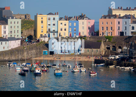 Tenby Harbour with boats at high tide at sunset Tenby Dinbych-y-Pysgod Pembrokeshire South West Wales UK - Stock Photo