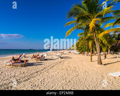 Jamaica, Negril, tourists sunbathing on the beach - Stock Photo