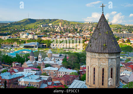 Tbilisi cityscape with church on foreground. Georgia - Stock Photo