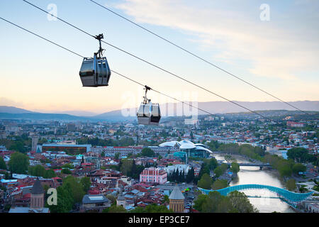 Cableway over the Tbilisi city at sunset. Georgia - Stock Photo