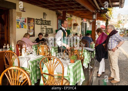 madeira restaurant; Waiter and customers at a restaurant in Funchal old town ( Zona Velha ), Funchal Madeira, Europe - Stock Photo