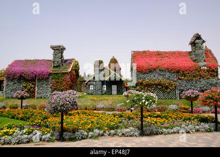 Houses covered in flowers at Miracle Garden Dubai United Arab Emirates - Stock Photo