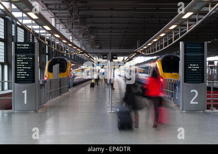 Passengers getting on the train at the St Pancras train station in London - Stock Photo