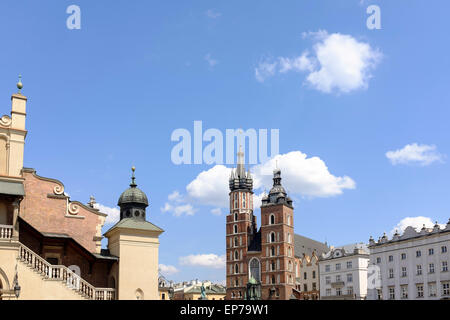 The basilica of the Virgin Mary's (or Kosciol Mariacki) at Krakow's central Square (Rynek Glowny) in Poland - Stock Photo