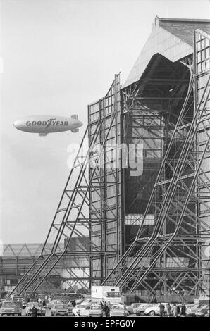 The Goodyear airship Europa seen here flying past the giant R101 sheds at RAF Cardington formerly the Royal Airship - Stock Photo