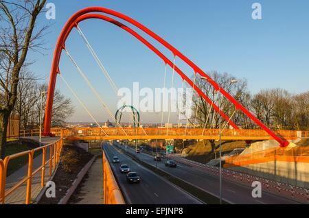 Footbridge across the road. Bridge for pedestrian over highway in Bydgoszcz City, Poland. - Stock Photo