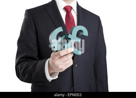 Businessman holding euro and pound signs with clipping path - Stock Photo