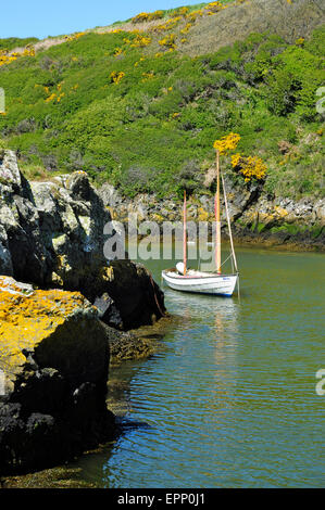 Yacht at anchor in the harbour at Porthclais (or Porth Clais), Pembrokeshire, Wales - Stock Photo