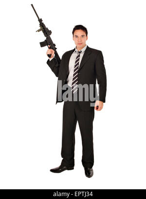 White man standing with an AR-15 Semi automatic gun - Stock Photo