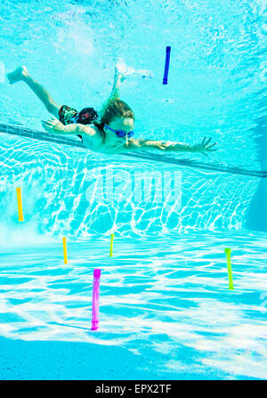 USA, Florida, Jupiter, Boy (8-9) swimming in pool - Stock Photo
