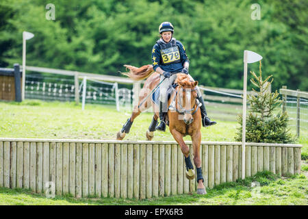Rockingham, UK. 22nd May, 2015. Horse and rider at the cross country event of the international horse trials on - Stock Photo