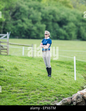 Rockingham, UK. 22nd May, 2015. Rider stands and watches the cross country event of the international horse trials - Stock Photo