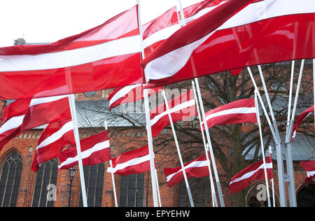 Latvian flags in front of the Riga Cathedral, Riga, Latvia - Stock Photo
