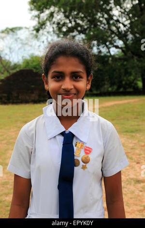 Portrait of school girl, Polonnaruwa, North Central Province, Sri Lanka, Asia - Stock Photo