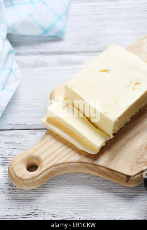 Delicious butter on wooden background, food - Stock Photo