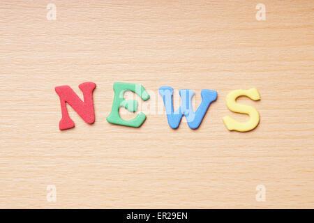 news in foam rubber letters - Stock Photo