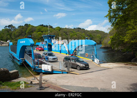 King Harry Ferry across the River Fal between Feock and Philleigh, Cornwall.  Cars disembarking at the Philleigh - Stock Photo