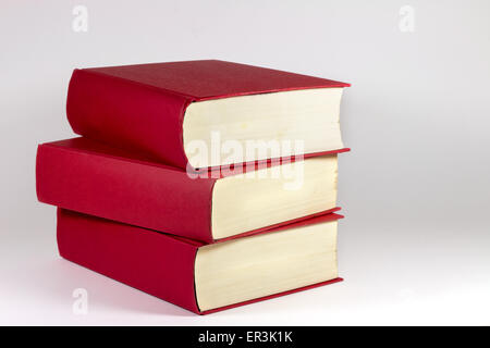 Three red books in white background - Stock Photo