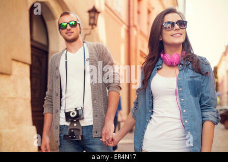 Stylish couple walking in the city. Krakow, Poland - Stock Photo