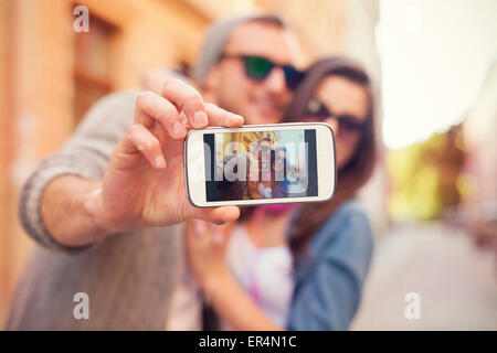 Young couple taking selfie in the city. Krakow, Poland - Stock Photo