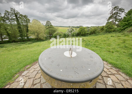 Millennium sundial (year 2000) outside the church of St Michael and All Angels, dating mainly from the thirteenth - Stock Photo