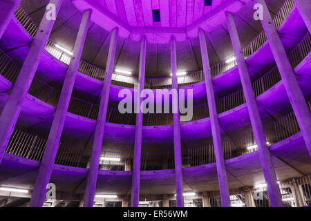 Spiral parking garage  Ossenmarkt in Groningen, The Netherlands. Purple color coming from the ever changing lighting - Stock Photo