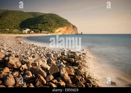 Surf on a rocky beach in Petrovac near Budva, Adriatic coastline, Montenegro, Western Balkan, Europe, long time - Stock Photo