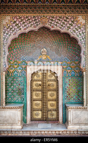 Rose gate door in City Palace of Jaipur, Rajasthan, India - Stock Photo