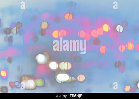 Abstract irregular blue blurred background with pink bokeh globes (blurred) - Stock Photo