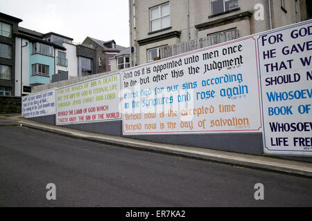 evangelical christian slogans on the wall of a house in northern ireland - Stock Photo