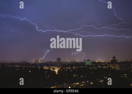 lightning strikes over night town during a thunderstorm. Kiev, U - Stock Photo