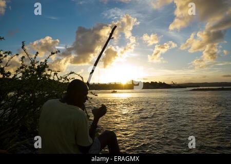 Man playing Berimbau at Itacaré, Bahia, Brazil - Stock Photo