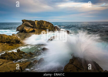 Rocks and waves in the Pacific Ocean at Monument Point, Heisler Park, Laguna Beach, California. - Stock Photo
