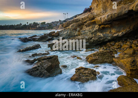 Rocks and waves in the Pacific Ocean at sunset, at Monument Point, Heisler Park, Laguna Beach, California. - Stock Photo