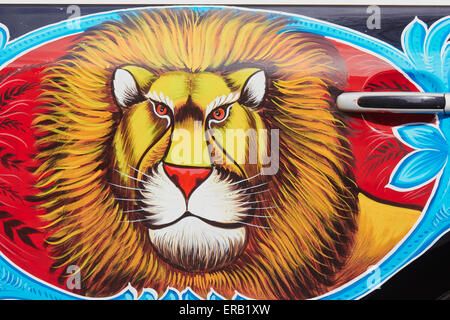 Volkswagen Beetle painted in traditional flamboyant style of Pakistani truck art, here with a lion. Montmartre Paris - Stock Photo