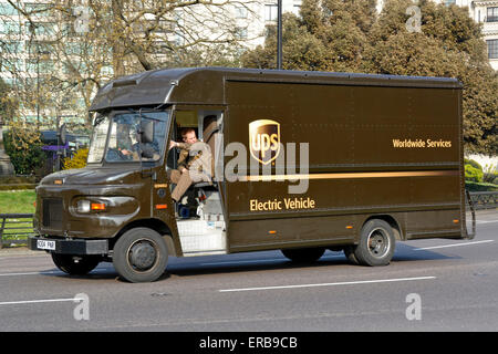 Electric Vehicle United Parcel Service UPS supply chain electric delivery van crew driver and mate - Stock Photo