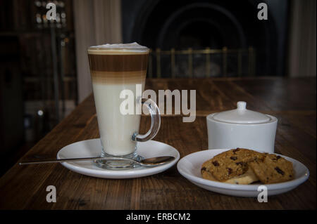 a latte coffee in a glass - Stock Photo