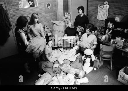 Staff at the Official Beatles Fan Club in Monmouth Street , Soho, London wade through the thousands of letters that - Stock Photo