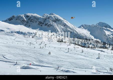 Rescue helicopter at Alpe Tognola, San Martino di Castrozza, Trentino, South Tyrol, Italy - Stock Photo