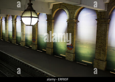 Gloucester Road underground station, London, UK. A large scale photographic mural between the arches of this West - Stock Photo