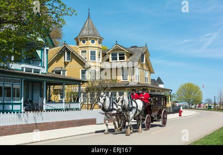 Michigan, Mackinac Island, horse-drawn carriage from Grand Hotel - Stock Photo