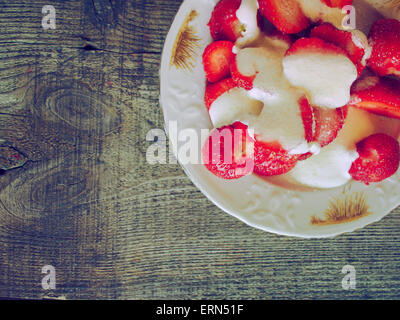 June 5, 2015 - homemade desert with cream and fresh strawberry on weathering wooden background. Grunge style. (Credit - Stock Photo