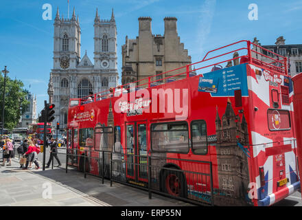 London City sightseeing open top tour bus with Westminster Abbey in the background, London, England UK - Stock Photo
