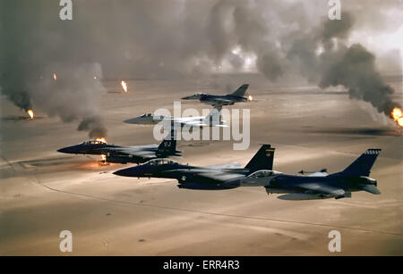 US Air Force F-16 and F-15 fighter aircraft in formation over burning Kuwaiti oil wells during Operation Desert - Stock Photo