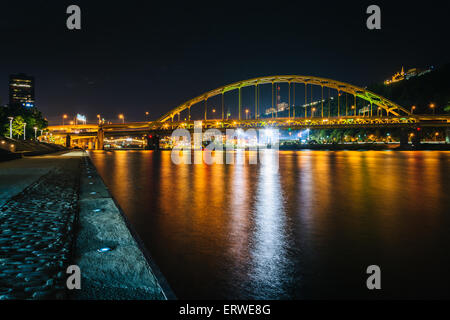 Fort Pitt Bridge at night, seen from Point State Park, in Pittsburgh, Pennsylvania. - Stock Photo