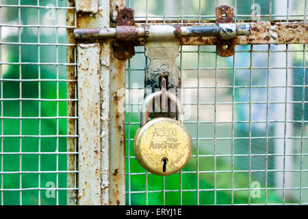 Old rusty door with lock ; Bombay Mumbai ; Maharashtra ; India - Stock Photo