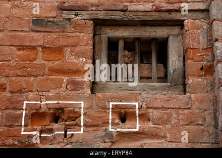 Bullet marks visible on preserved wall at Jallianwala or Jalianwala Bagh ; Amritsar ; Punjab ; India - Stock Photo