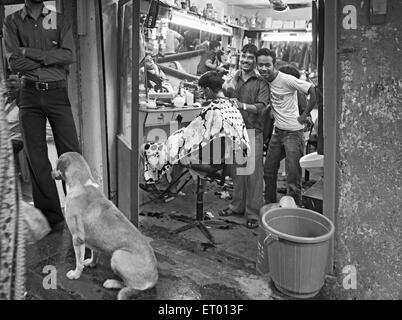 Barber shop in Dharavi slum ; Bombay Mumbai ; Maharashtra ; India NO MR - Stock Photo