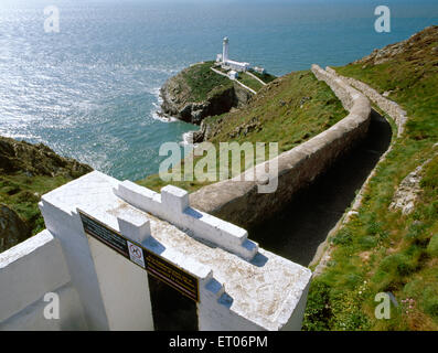 Gateway & access path leading to South Stack lighthouse on a small, rocky island in the Irish Sea W of Holyhead, - Stock Photo